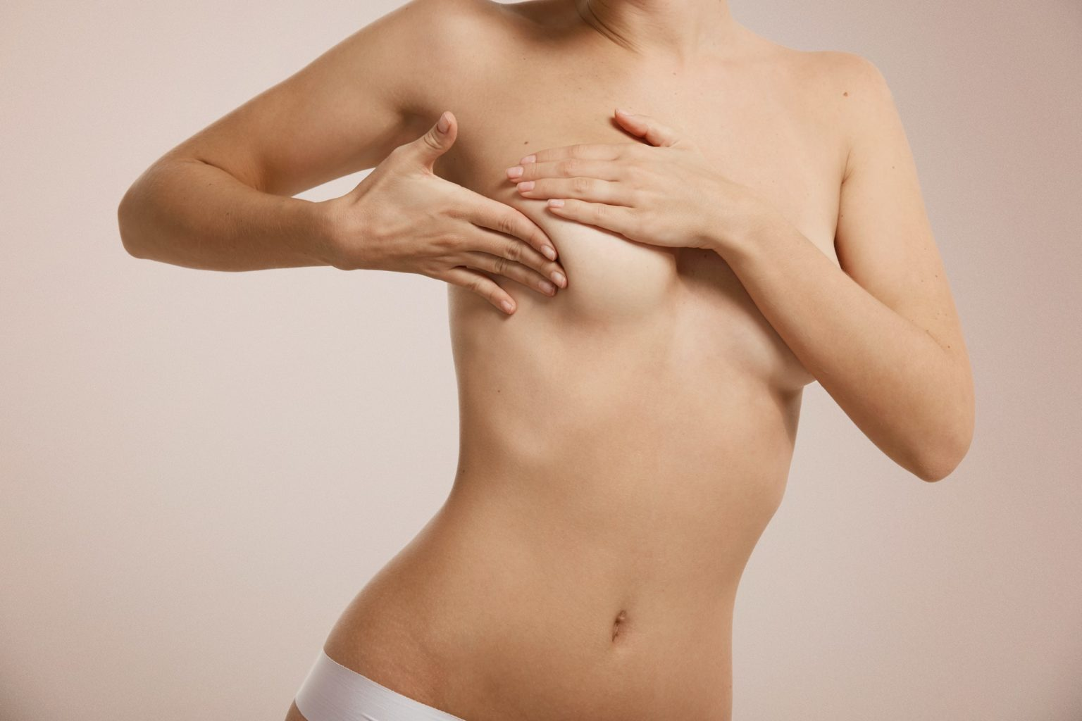 Breast cancer concept - woman checking her breast.